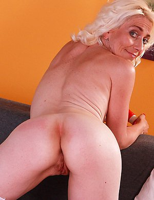 Horny blonde housewife playing with her toy